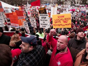LANSING, MI, - DECEMBER 11: Union members from around the country rally at the Michigan State Capitol to protest a vote on Right-to-Work legislation December 11, 2012 in Lansing, Michigan. Republicans control the Michigan House of Representatives, and Michigan Gov. Rick Snyder has said he will sign the bill if it is passed. The new law would make requiring financial support of a union as a condition of employment illegal. (Photo by Bill Pugliano/Getty Images)
